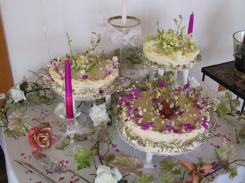 Wedding cake decorated with flower petals.